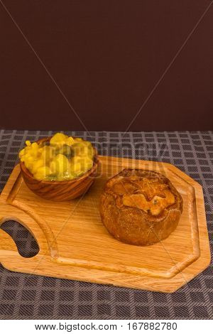 Game Pie Served With Bowl Of Piccalilli