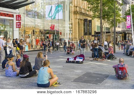 Brisbane, Australia - September 26, 2016: View of street performers singing at the Queen Street Mall in Brisbane CBD.