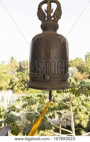 The ancient bronze bell hangs and waits when call it
