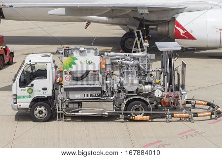 Brisbane, Australia - September 27, 2016: Close-up of fuel truck from Air BP, who specialises in selling aviation fuels, pumping fuel into Qantas aircraft at Brisbane Airport.