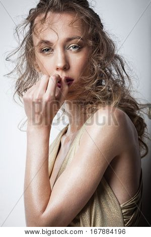 creative hairstyle and makeup concept - young fashion model posing in studio