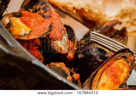 Fresh Steamed Mussels in tomato and herbs sauce, spicy seafood. - rich source of easily digestible high-quality protein