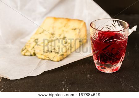 Glass Of Sloe Gin With Stilton Cheese