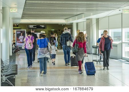 Brisbane, Australia - September 27, 2016: View of travellers proceeding to departure gate for boarding at Brisbane Airport.