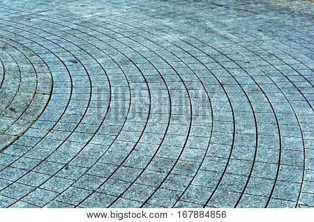 paving slabs in a circle the tiles covering the bulge of the fountain