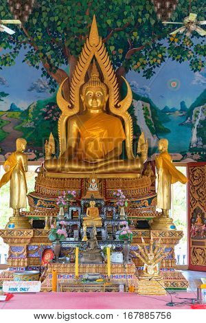 Golden Statue Of Sitting Buddha In A Temple