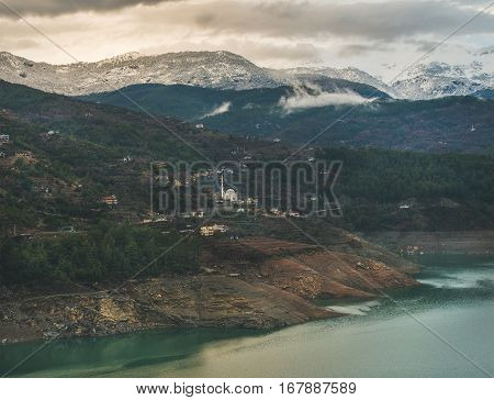 Dim Cay storage pond and mountains covered with snow in Alanya, Southern Turkey