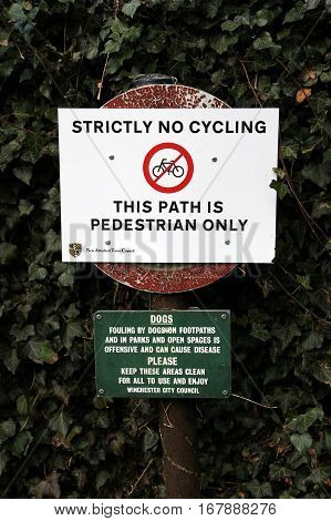 New Alresford, Uk - Jan 28 2017: Strictly No Cycling Sign, And Dog Fouling Sign, On A Pedestrian Pat