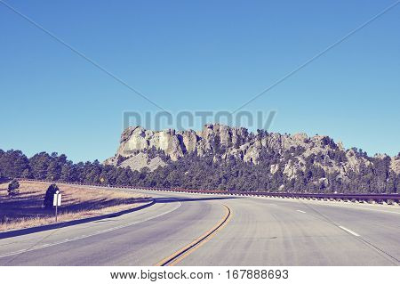 Retro Color Toned Road To Mount Rushmore National Memorial, Usa.