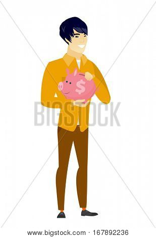 Widely smiling asian business man holding pink piggy bank with dollar sign. Full length of young business man with piggy bank in hands. Vector flat design illustration isolated on white background.