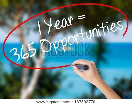 Woman Hand Writing 1 Year = 365 Opportunities With Black Marker On Visual Screen