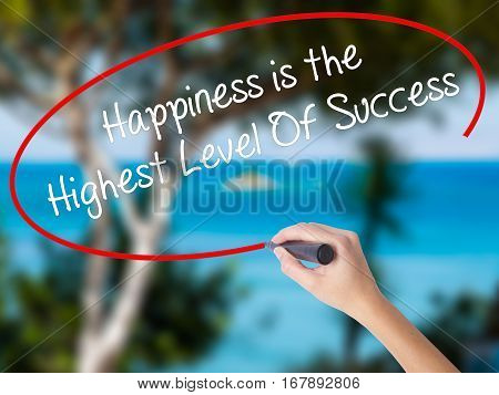 Woman Hand Writing Happiness Is The Highest Level Of Success With Black Marker On Visual Screen