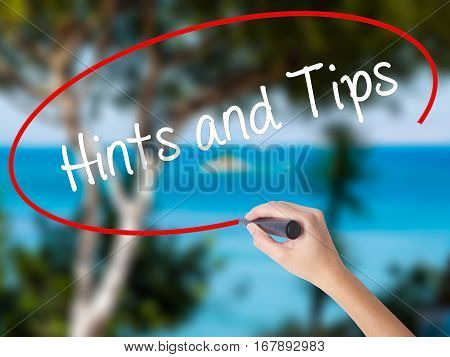 Woman Hand Writing Hints And Tips With Black Marker On Visual Screen