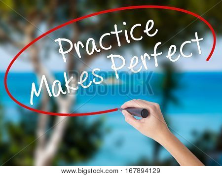 Woman Hand Writing Practice Makes Perfect With Black Marker On Visual Screen