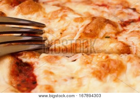 Fresh baked pizza Margherita tomato and Mozzarella cheese - background. Pizza wallpaper. Margharita pizza closeup background. Vegetarian pizza macro texture cheese and tomato.