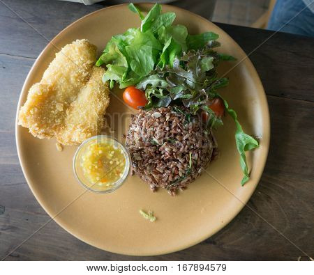Deep Fried Dolly Fish Steak with sauce Stir basil crispy herb hot and spicy delicious Thai food style