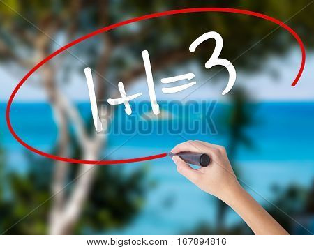 Woman Hand Writing 1+1=3 With Black Marker On Visual Screen