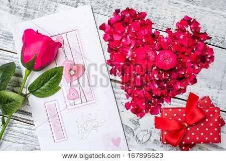 Valentine's day and Sweetest day love concept. Heart made from flower petals.