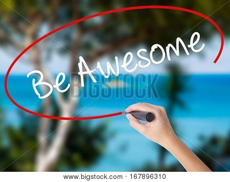 Woman Hand Writing Be Awesome With Black Marker On Visual Screen