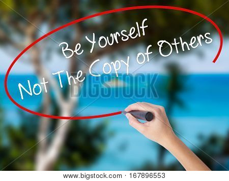 Woman Hand Writing Be Yourself Not The Copy Of Others With Black Marker On Visual Screen