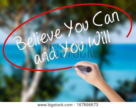 Woman Hand Writing Believe You Can And You Will With Black Marker On Visual Screen