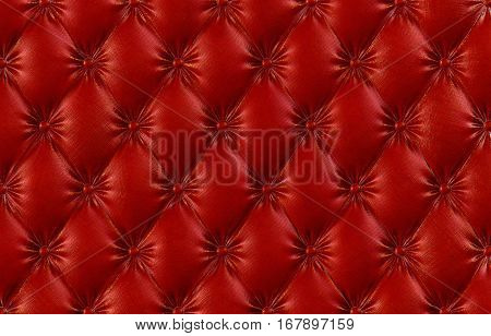 luxurious texture of red leather upholstery. 3D illustration.