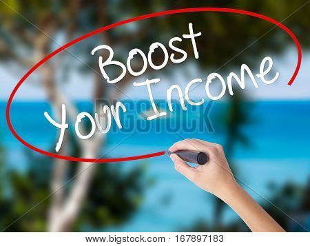Woman Hand Writing Boost Your Income With Black Marker On Visual Screen