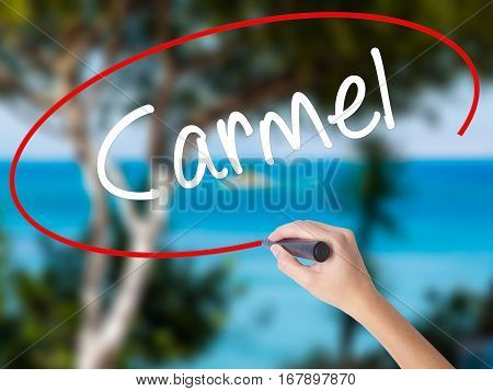 Woman Hand Writing Carmel With Black Marker On Visual Screen