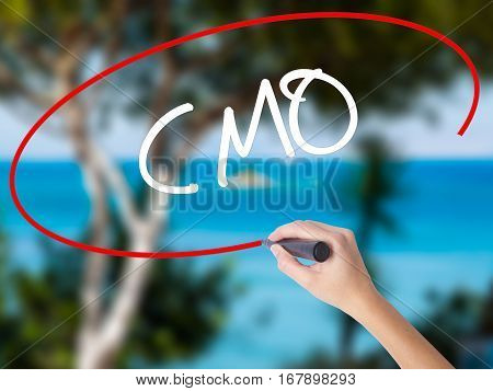 Woman Hand Writing Cmo (chief Marketing Officer)   With Black Marker On Visual Screen