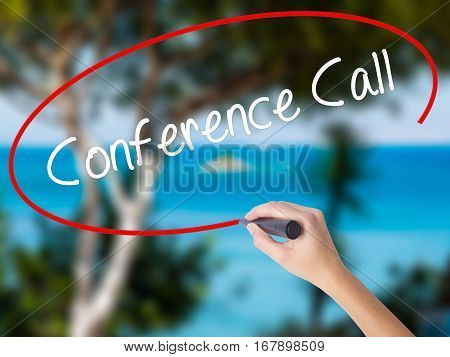 Woman Hand Writing Conference Call With Black Marker On Visual Screen.