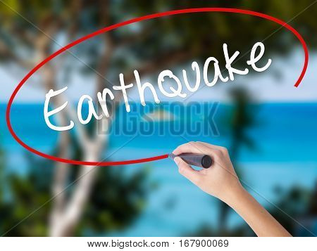 Woman Hand Writing Earthquake With Black Marker On Visual Screen