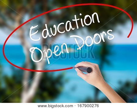 Woman Hand Writing Education Open Doors With Black Marker On Visual Screen