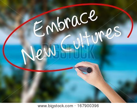 Woman Hand Writing Embrace New Cultures With Black Marker On Visual Screen