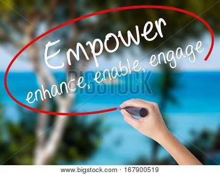 Woman Hand Writing Empower Enhance, Enable, Engage With Black Marker On Visual Screen