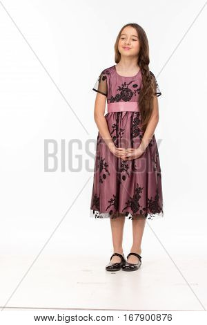 Long haired girl of six years in a summer dress isolated on white background.