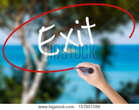 Woman Hand Writing Exit With Black Marker On Visual Screen