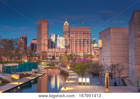 Cityscape image of downtown Indianapolis, Indiana during twilight blue hour.