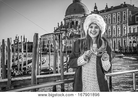 Smiling Fashion-monger In Venice, Italy Holding Venetian Mask
