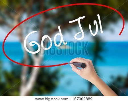 Woman Hand Writing God Jul  (merry Christmas In Swedish) With Black Marker On Visual Screen