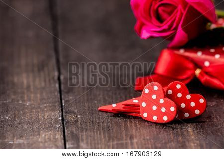 Valentine's day and Sweetest day love concept. Red and white polka dot hearts on rustic wood boards. Holiday background with copy space.