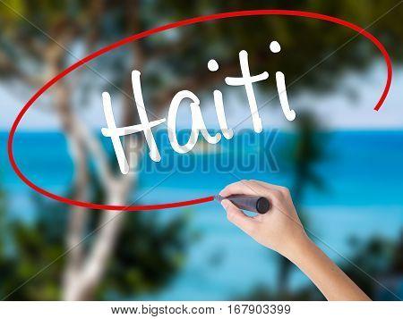 Woman Hand Writing Haiti With Black Marker On Visual Screen