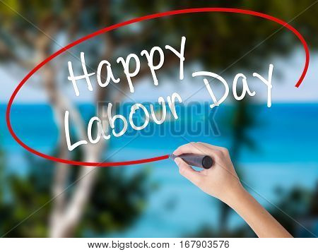 Woman Hand Writing Happy Labor Day With Black Marker On Visual Screen