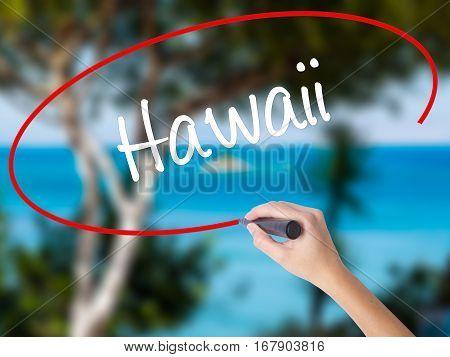 Woman Hand Writing Hawaii  With Black Marker On Visual Screen