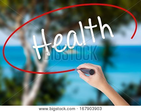 Woman Hand Writing Health With Black Marker On Visual Screen