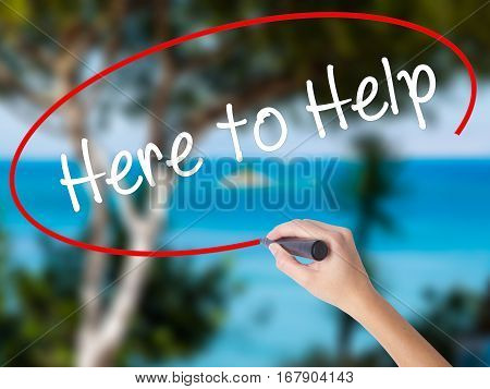 Woman Hand Writing  Here To Help With Black Marker On Visual Screen