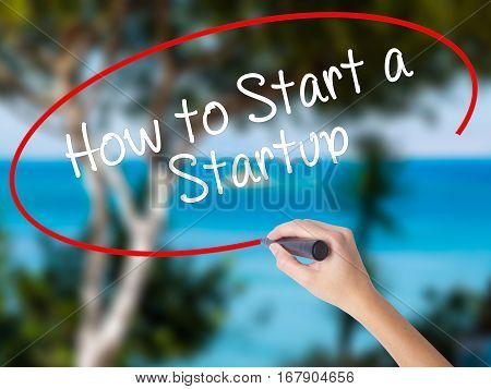 Woman Hand Writing How To Start A Startup With Black Marker On Visual Screen