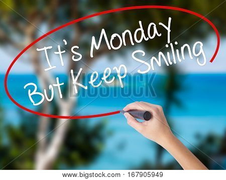 Woman Hand Writing It's Monday But Keep Smiling With Black Marker On Visual Screen