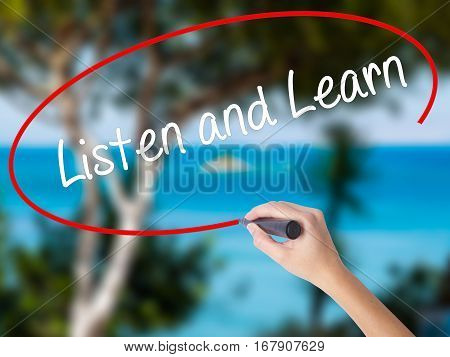 Woman Hand Writing Listen And Learn With Black Marker On Visual Screen