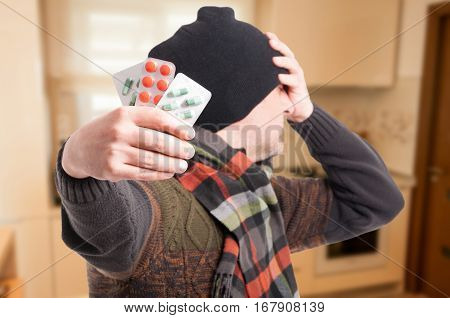Male With Headache Showing Blister With Pills