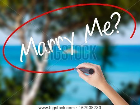 Woman Hand Writing Marry Me? With Black Marker On Visual Screen.